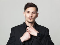 Studio portrait of handsome elegant young man in black  clothes Stock Photography