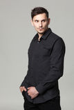 Studio portrait of handsome elegant young man in black  clothes Royalty Free Stock Images