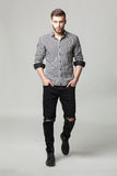 Studio portrait of handsome elegant young man in casual clothes Stock Photo