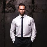 Handsome man wearing white shirt on a grunge background. stock image