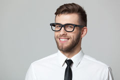 Studio portrait of handsome young businessman smiling and winkin Royalty Free Stock Photo