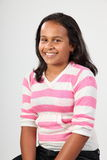 Studio portrait of happy ethnic school girl 11 Stock Images