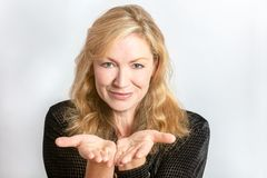 Studio Portrait of Healthy Happy Middle Aged Woman Hands Out stock image