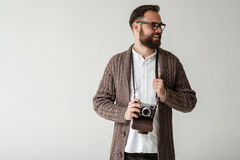 Studio portrait of hipster photographer Stock Photos