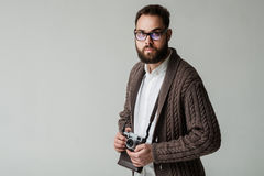 Studio portrait of hipster photographer Stock Images