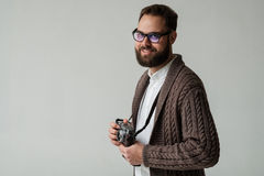 Studio portrait of hipster photographer Stock Photo