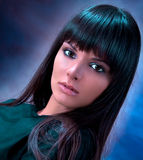 Studio portrait of Indian beauty. Brunette with black hair Royalty Free Stock Image