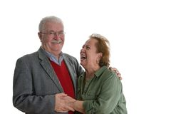 Studio portrait of laughing elderly couple royalty free stock photo