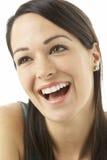 Studio Portrait Of Laughing Woman Stock Photo