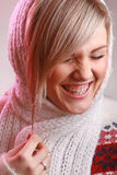 Studio portrait of laughing woman. Young woman laughing out loud Stock Photography