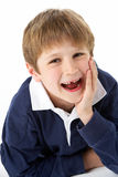 Studio Portrait Of Laughing Young Boy Stock Photo