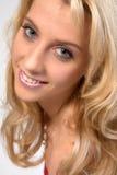 Studio portrait of a long blond girl flirting Royalty Free Stock Photos