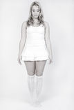 Studio portrait of a long blond girl standing Stock Photo