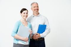 Studio Portrait Of Male And Female Pre School Teachers Royalty Free Stock Photos