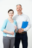 Studio Portrait Of Male And Female Pre School Teachers. Smiling Royalty Free Stock Image