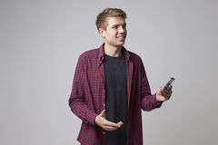 Studio Portrait Of Male Journalist With Digital Recorder Stock Images