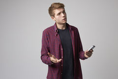 Studio Portrait Of Male Journalist With Digital Recorder Stock Photos