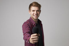 Studio Portrait Of Male Journalist With Microphone Royalty Free Stock Photo