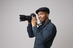 Studio Portrait Of Male Photographer With Camera royalty free stock photography