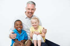 Studio Portrait Of Male Pre School Teacher With Pupils Royalty Free Stock Images