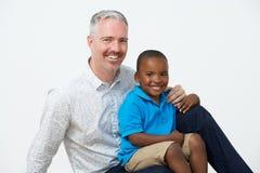 Studio Portrait Of Male Pre School Teacher With Pupils Stock Image