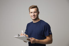 Studio Portrait Of Male Sports Coach With Clipboard Stock Images