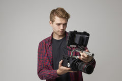 Studio Portrait Of Male Videographer With Film Camera Royalty Free Stock Images