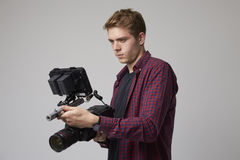 Studio Portrait Of Male Videographer With Film Camera Royalty Free Stock Image