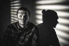 Studio portrait of man in shadows Stock Image