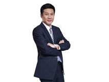 Asian businessman. Studio portrait of a mid-adult asian businessman with arms crossed Stock Image