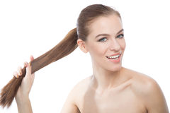 Studio portrait of a model showing her healthy shining hair Royalty Free Stock Image