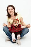 Studio portrait of mother and baby daughter Stock Photography