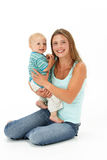 Studio Portrait Of Mother Holding Son Royalty Free Stock Photography