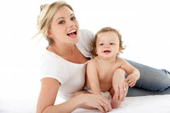 Studio Portrait Of Mother With Young Baby Boy Stock Photography