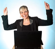 Studio Portrait Of A Cute Blond Girl With A Computer Hands Up Stock Image