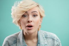 Free Studio Portrait Of A Young Attractive Blonde Girl Singing The Song Stock Photography - 123985602