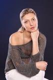 Studio portrait of pensive woman Stock Photo