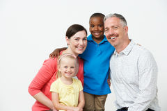 Studio Portrait Of Pre School Teachers With Pupils. Smiling To Camera Royalty Free Stock Images