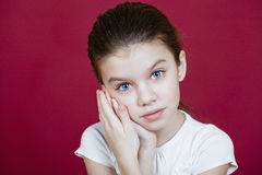 Studio portrait of a pretty little girl Stock Images