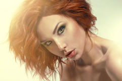 Studio portrait of pretty redhead woman Stock Image