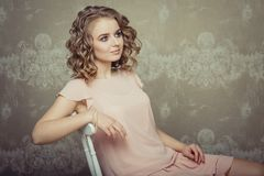 Pretty woman portrait in light interior Stock Photos