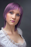 Studio portrait of pretty young woman. With lilac hair stock image