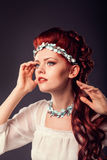 Studio portrait of redhead girl close-up. Royalty Free Stock Photography
