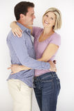 Studio Portrait Of Romantic Couple Embracing Against White Backg Royalty Free Stock Photos