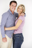 Studio Portrait Of Romantic Couple Embracing Against White Background Royalty Free Stock Photo