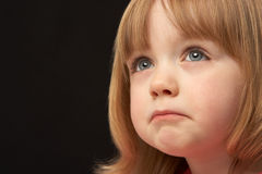 Studio Portrait Of Sad Young Girl Royalty Free Stock Photos