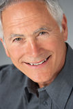 Studio Portrait Of Senior Man Stock Photo