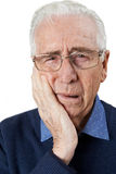 Studio Portrait Of Senior Man Suffering With Toothache Royalty Free Stock Image