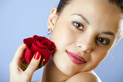 Studio portrait of sensual  woman with rose Stock Photo