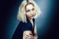 Studio portrait of serious blond woman